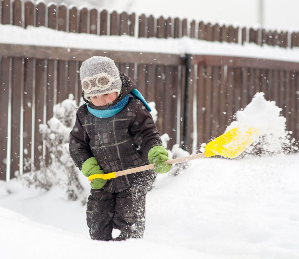 kid shoveling snow in Cleveland Ohio